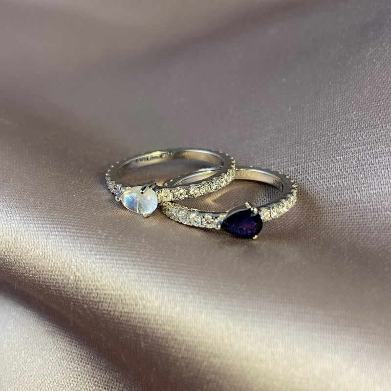 Full diamond Eternity band with a pear shaped Birthstones. 18K gold