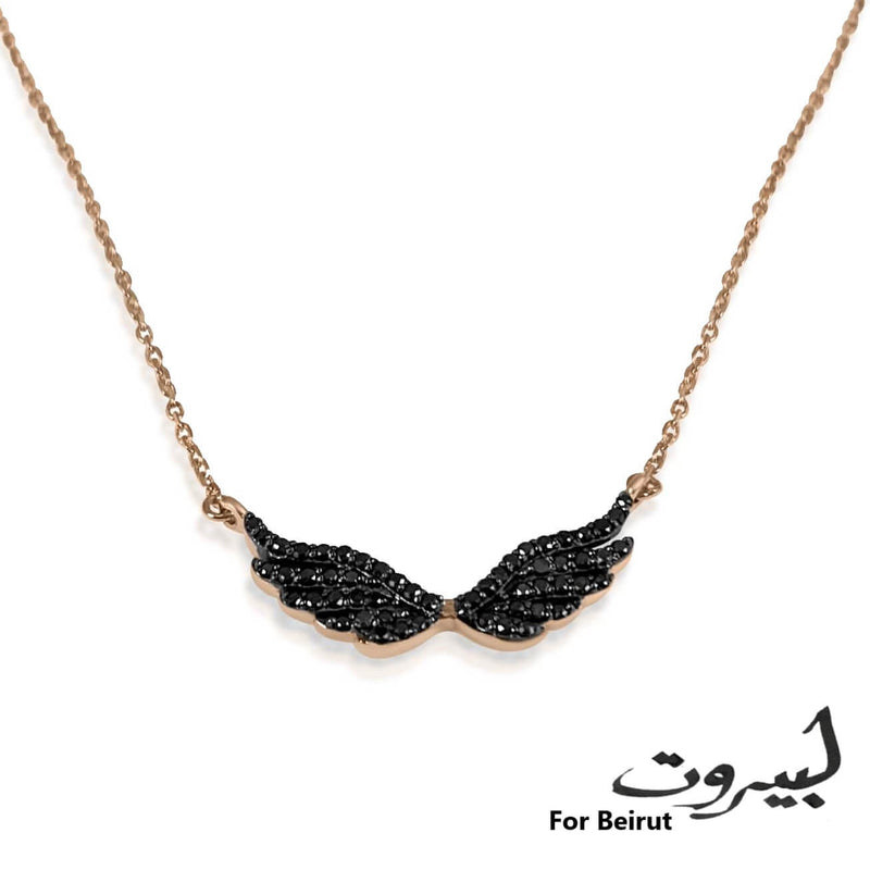 Beautiful black diamond wing necklace to symbolize the rise of Beirut from ashes! All proceed from the sales will go the Lebanese Red Cross.    18K Solid Gold (2.7g), 54 Diamond stones (0.24 carats), MADE IN BEIRUT!