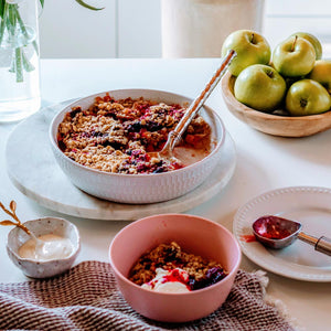 The ultimate apple and mixed berry crumble in a serving dish