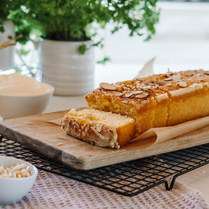 Orange and almond log sliced on a bread board