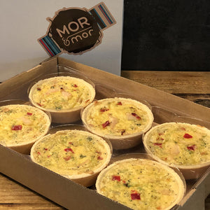 Six individual quiches in cardboard packaging