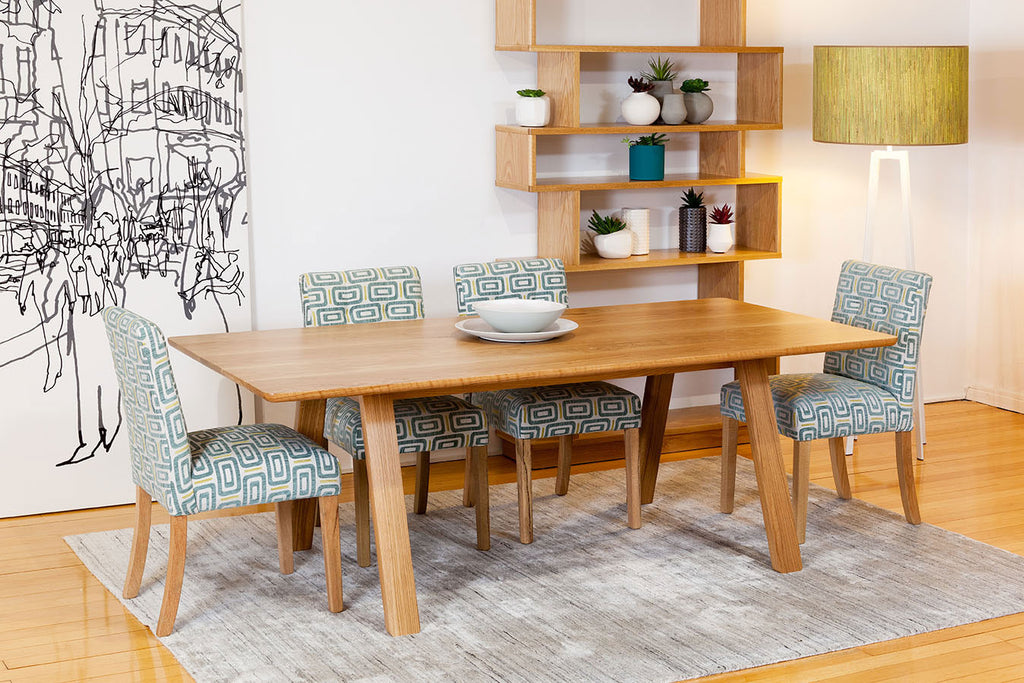 Trestle Solid American Oak Timber Dining Table featured with American Oak Shelving Unit and Marrimeko Wall Art