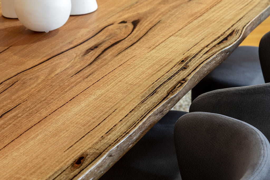 Axis solid Marri dining table natural edge detail