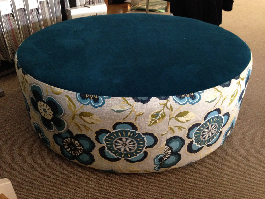 Oreo Large Round Ottoman upholstered in blue floral fabric