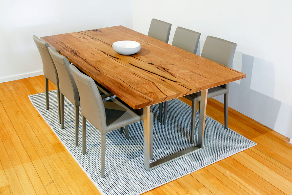 Mondo Marri Dining Table with Stainless Steel Base shown with leather dining chairs