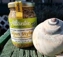 Load image into Gallery viewer, Dijon mustard in a jar beside a big shell