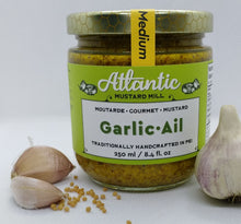 Load image into Gallery viewer, A bigger jar of mustard with a whole garlic and some cloves