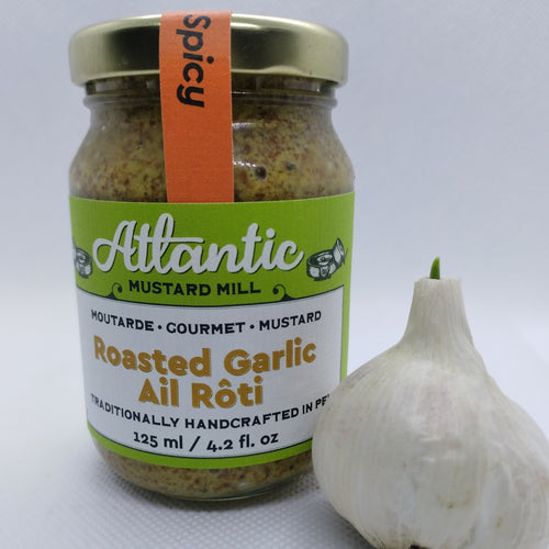 A jar of Roasted Garlic Mustard with a whole garlic beside