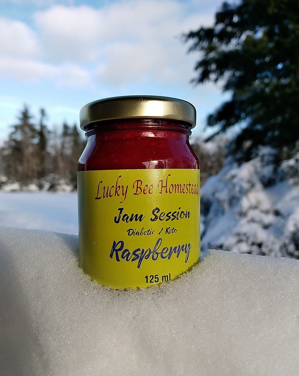 a jar of jam stuck in some snow