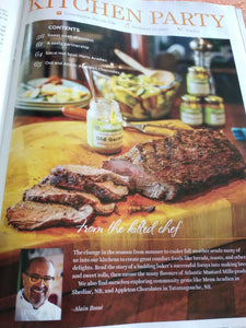 A page from the Saltscapes Magazine with a foto of the Kilted Chef and a rack of meat with the mustard in the background