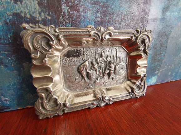 Antique metal ashtray featuring musicians