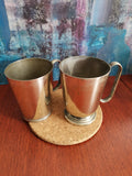Two silver-plated pint-sized mugs - tankards