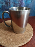 Two silver plated half pint mugs - tankards