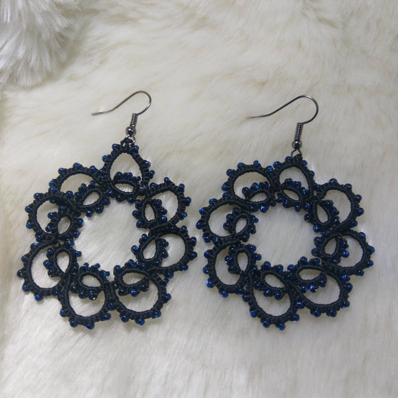 Tatted handmade laced black threaded earrings with featured blue beads.