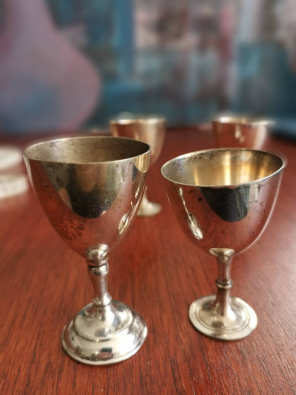 4 silver goblets small. Imperfect.