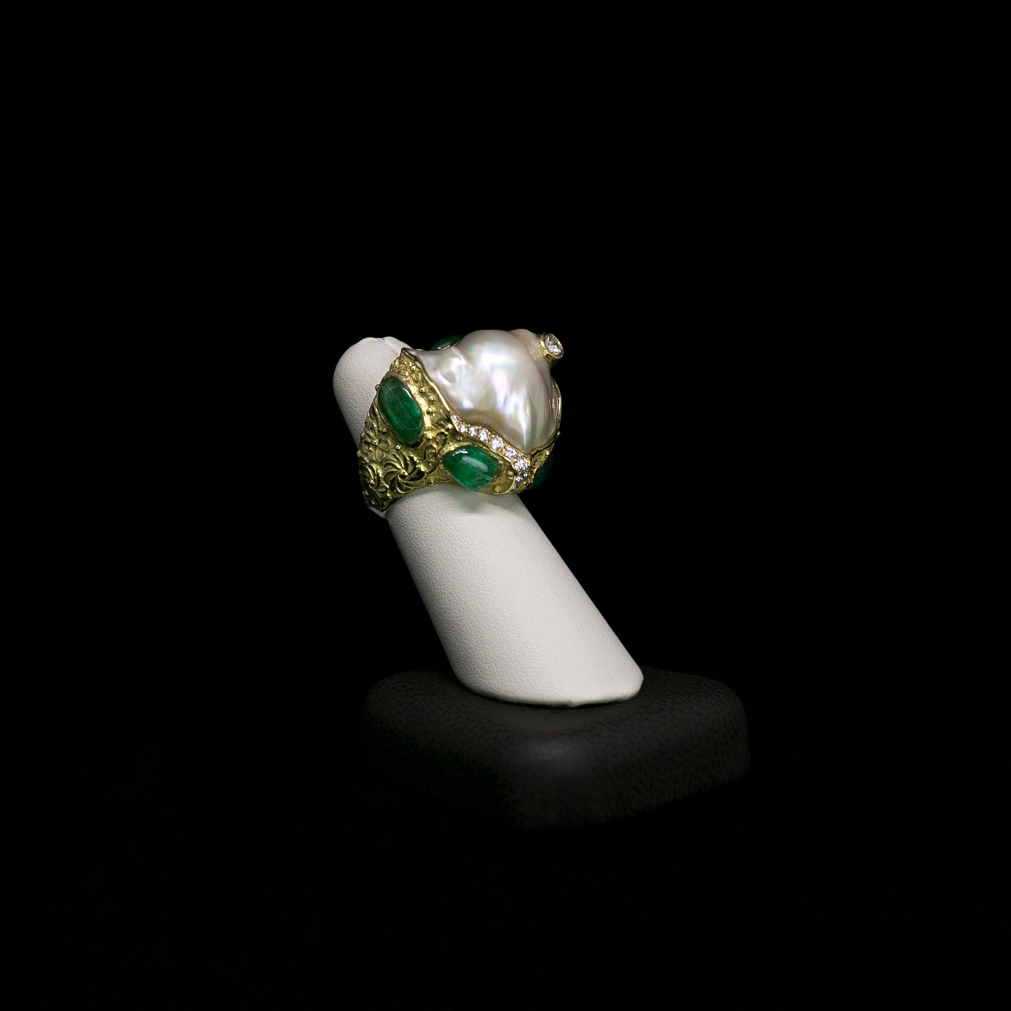 Henri Noël Jewelry vintage baroque pearl ring with emerald and diamond surrounds and set in gold.