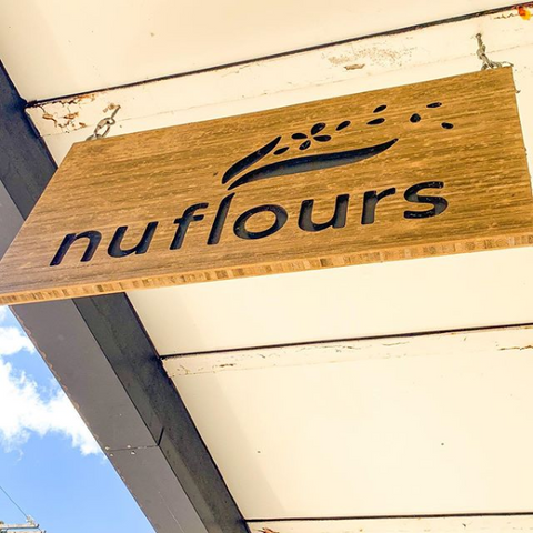 Wooden Nuflours bakery sign outside of the store in Capitol Hill, Seattle, Washington.