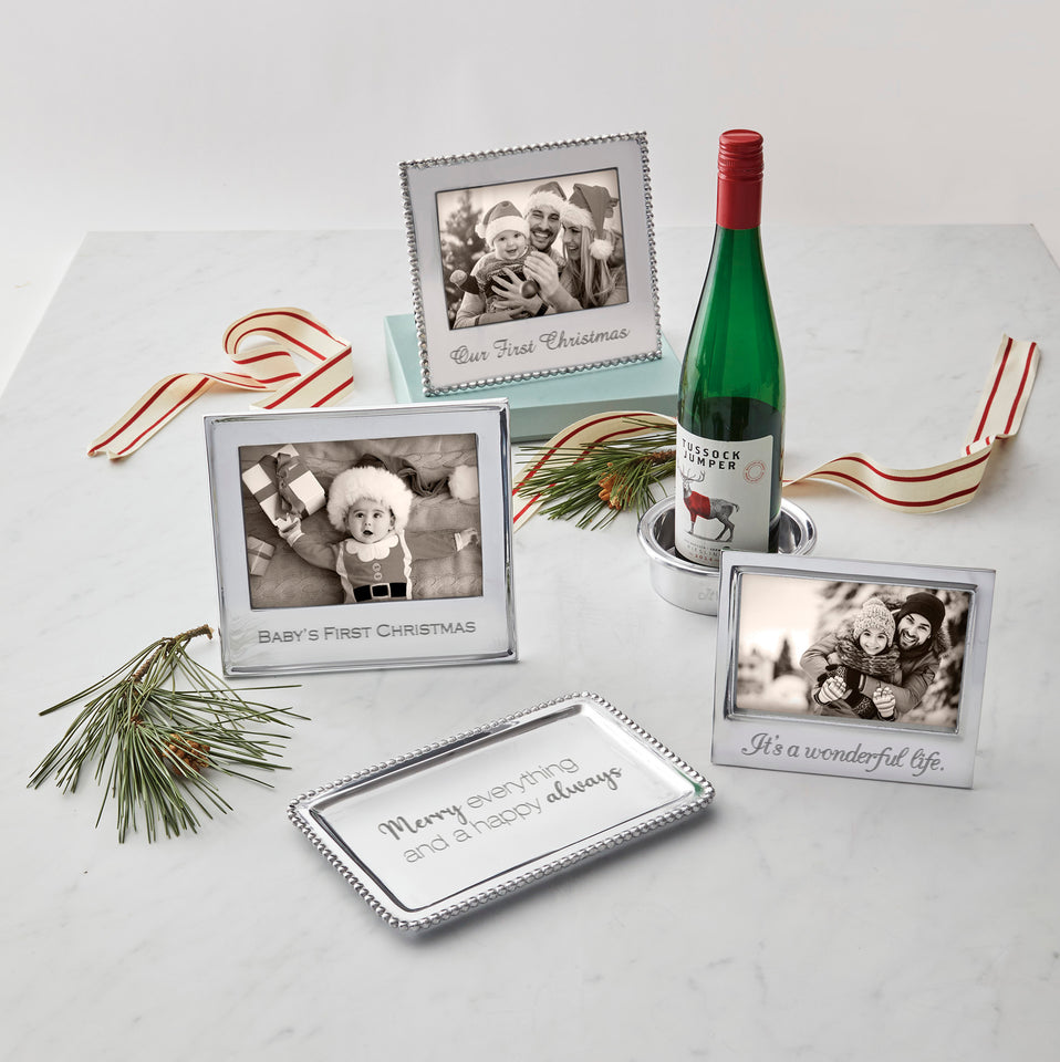 silver picture frames and silver candle holders