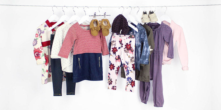 Multiple outfits hung on a clothesline