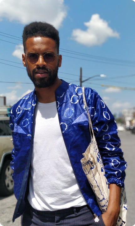 Blue men's bombers with cowrie shell pattern