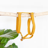 Linen dog harness in mustard yellow with silver hardware