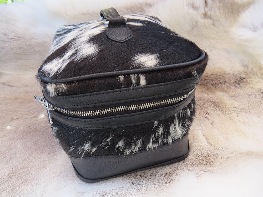Load image into Gallery viewer, Cowhide toiletry bag - black + white