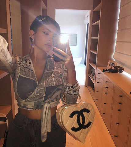 Kylie Jenner Wearing Chanel vintage heart bag