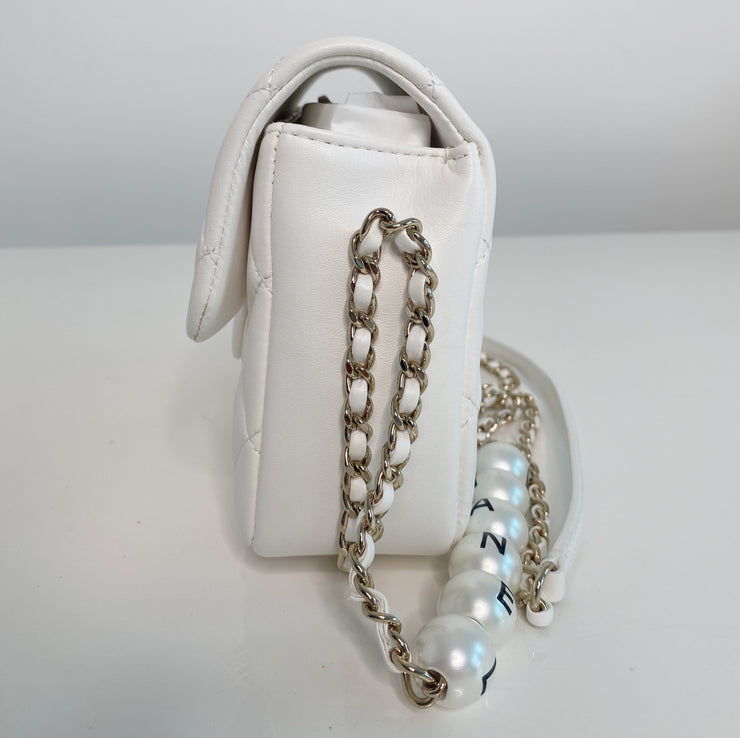 Chanel Pearl Logo Strap Flap Bag White