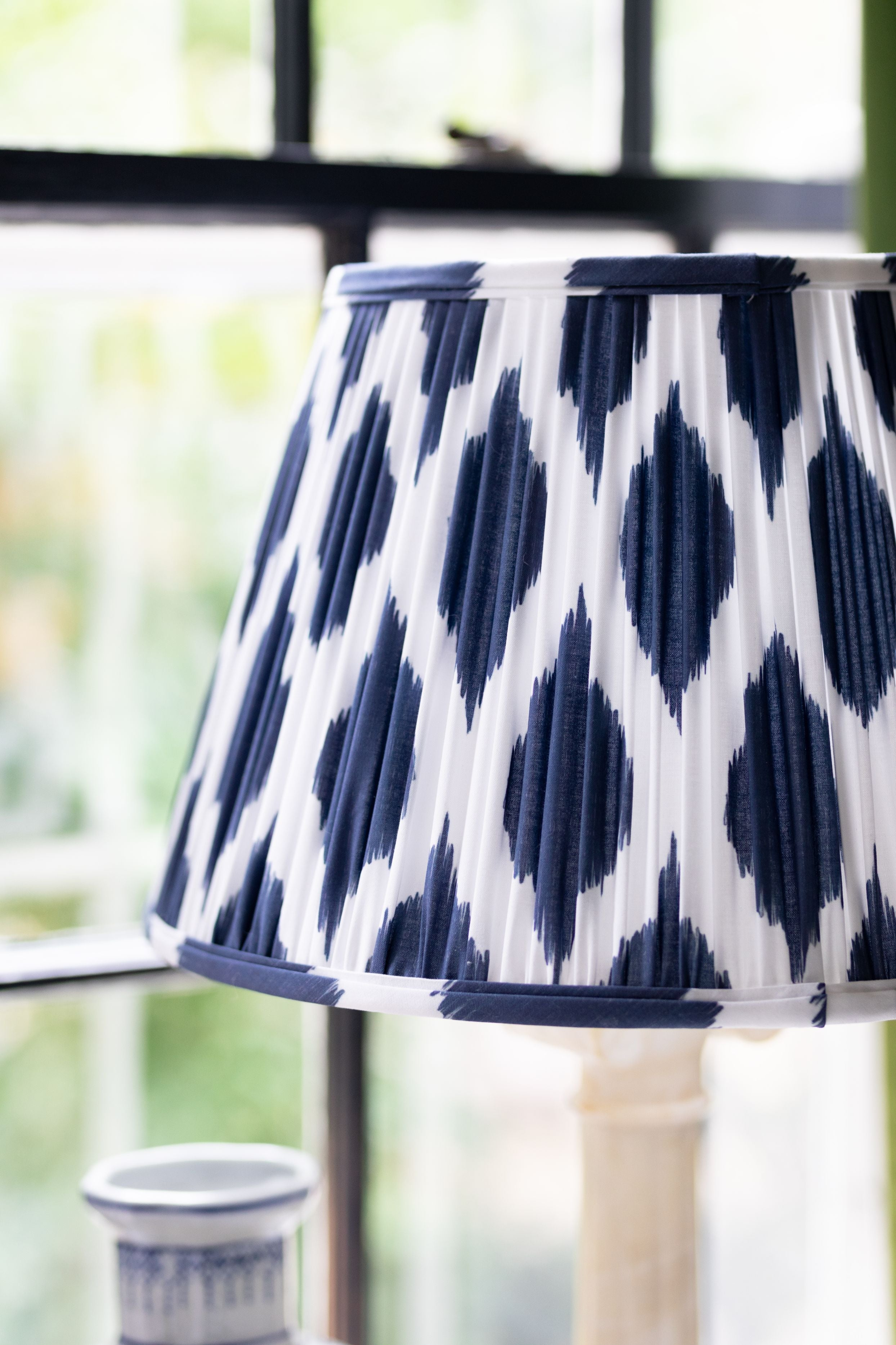 Close up of the detail on a navy blue and white lamp shade.
