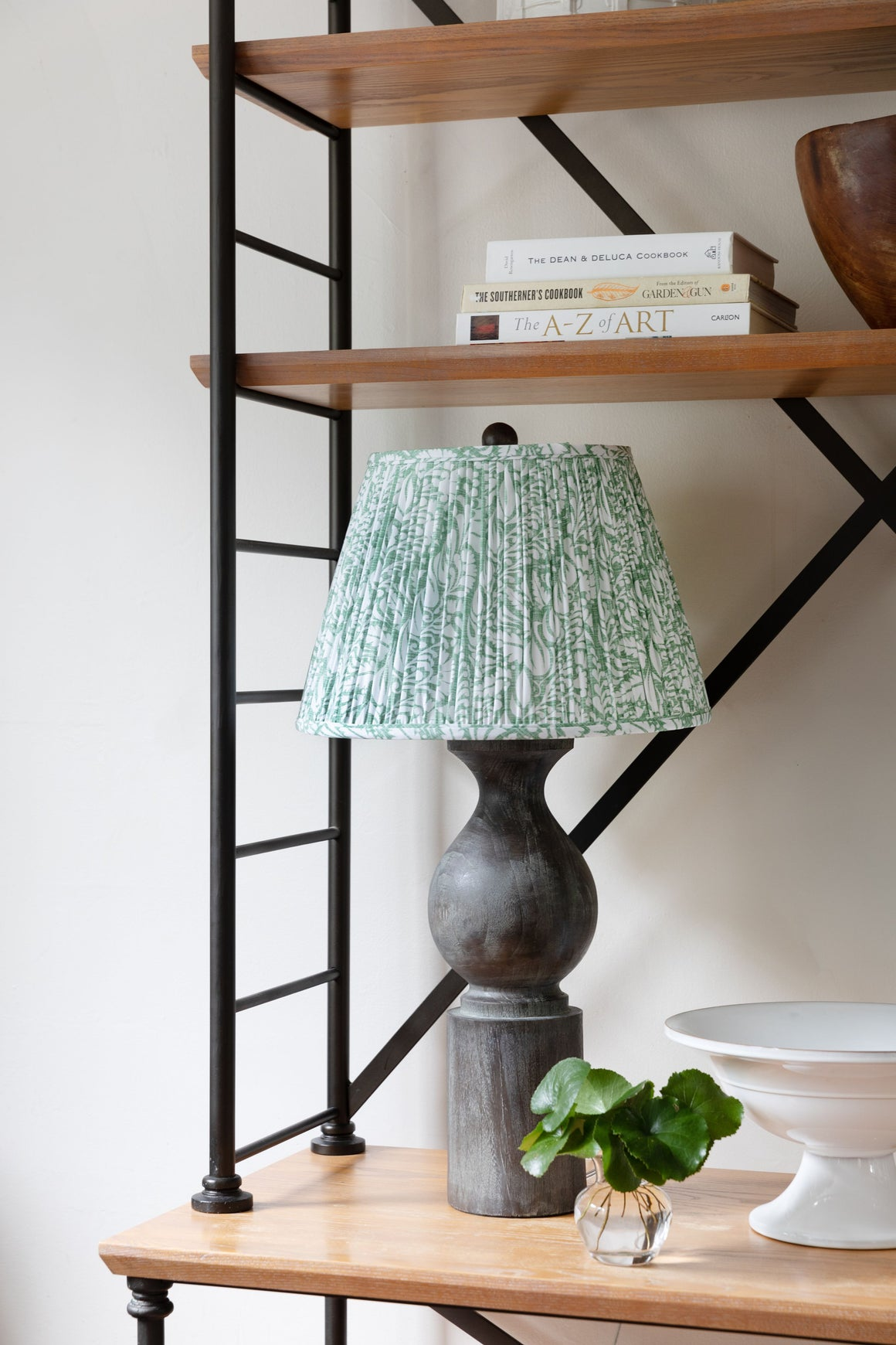 Green lamp with black base.