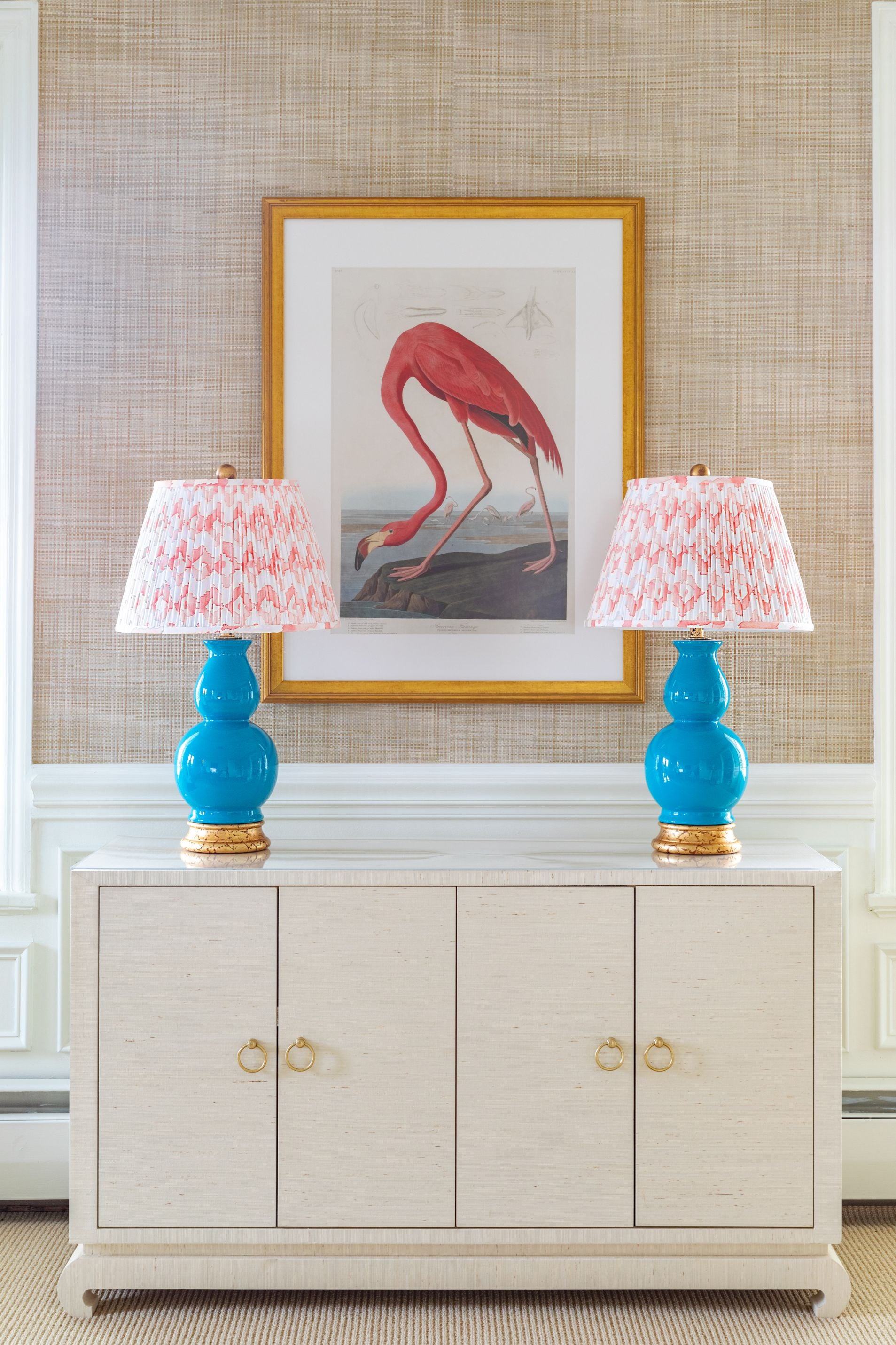 Peach colored patterned lamp shades.
