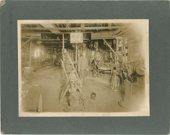 Mounted photo, machine shop interior with Roosevelt and Garner posters