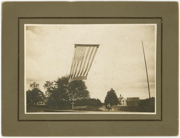 Exterior scene photo from Maine with a huge Taft & Sherman campaign flag
