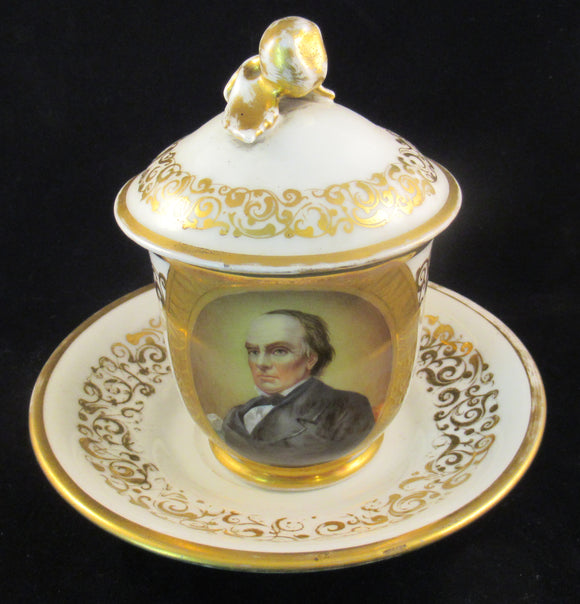 Daniel Webster lidded cup and matching saucer