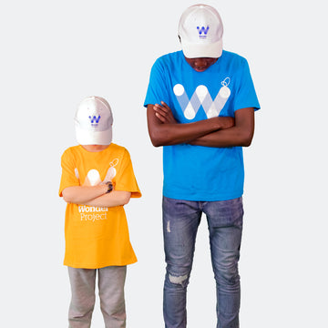 two males wearing Wonder Project hats