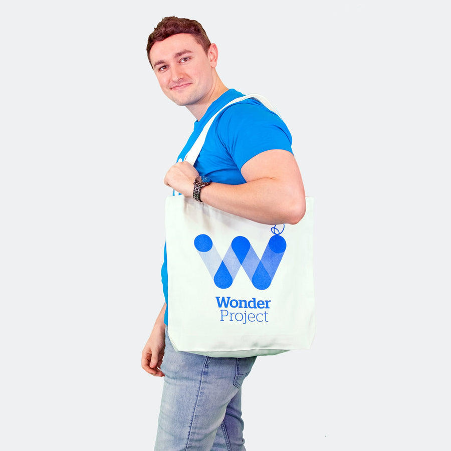 man with wonder project tote bag