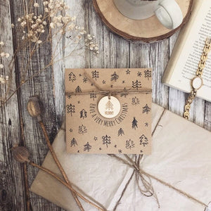 Kraft board christmas card with engraved wooden ornament tied with string