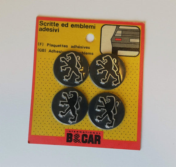 <p>Vintage set of 4 self adhesive Peugeot emblems, diameter is 40 mm - 1.57
