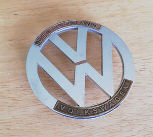 "<p>VW Beetle custom hood emblem. Made of high grade aluminum (4 mm thickness) and has special brass ""Deutschland"" and ""Volksw"