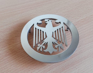 <p>VW Beetle hood emblem with custom Deutschland Eagle design. Made of high grade aluminum (4 mm thickness), it will not rust