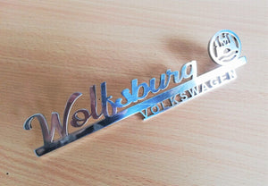 <p>Cutom Volkswagen Wolfsburg hood / decklid script with VW logo.</p> <p>Made of high grade aluminum (4 mm thickness), it wil
