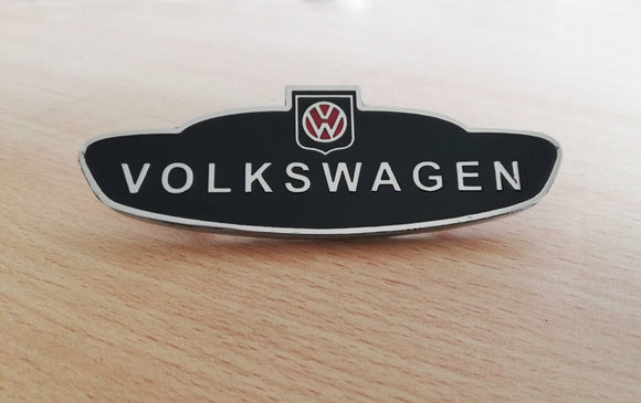 <p>Custom Volkswagen side enameled emblem.</p> <p>This badge will look awesome on the fenders of your beetle, bus, squareback