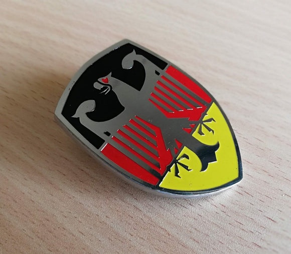 <p>German flag colors VW Deutschland Eagle Crest front hood enameled emblem / badge with a custom bolt type post aluminum bas