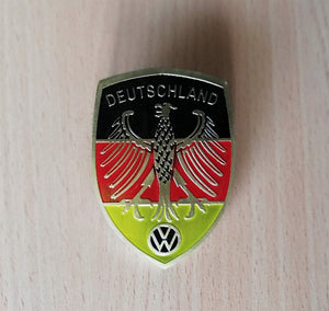 <p>German flag colors Deutschland Eagle and black VW logo crest front hood enameled emblem / badge with a custom bolt type po