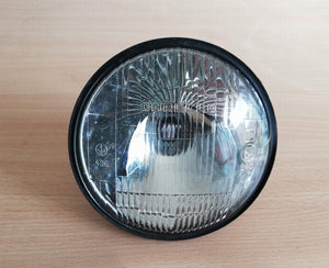 <p>NOS (New Old Stock) Carello headlight that would fit many classic Italian and European cars.</p> <p>Reflector part number
