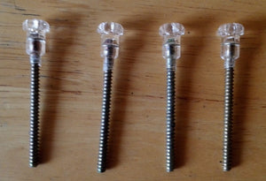 <p>Set of 4 clear lens screws for tailight or reverse light for use in many Italian classic cars including Fiat, Alfa Romeo,