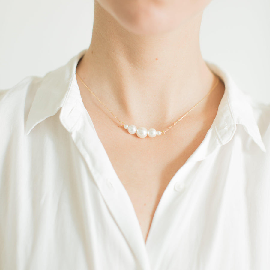 Delicate gold white pearl necklace