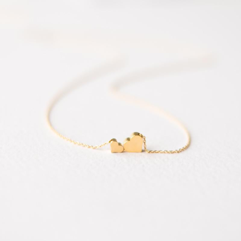 Delicate two gold hearts necklace