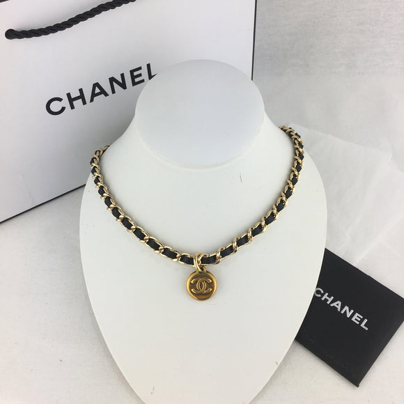 CHANEL Charm Necklace on Black Leather Chain