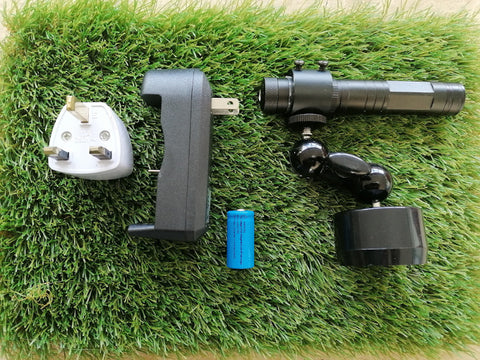 YellowDog laser training aid unit placed on green grass mat beside battery charged and battery with ring laser collar holder and adjustable double ball 360 swivel unit with easy locking thumb